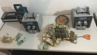 Police also seized two electronic currency counters and cryovac sealing equiment.