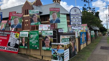 No line-up to vote at Vulture Street, East Brisbane, but a clear message from the polling booth host.