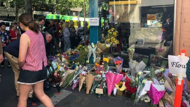 Flowers left outside Pellegrini's in Bourke Street in memory of attack victim Sisto Malaspina.