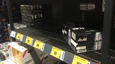 Beer and wine shelves were beginning to empty around Brisbane on Sunday night.