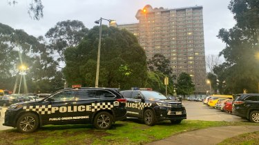 Police outside the Flemington public housing towers which were placed under 'hard lockdown' at 4pm on Saturday.