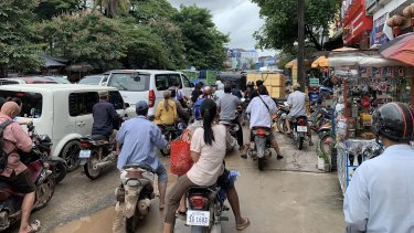 A traffic jam outside the main market place in down town Sihanoukville. It can take hours to drive just a few kilometres.