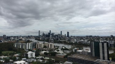 Storm clouds hang above Brisbane on Sunday morning.