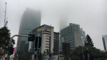 Thick fog coating Brisbane city on Tuesday morning.