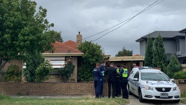 Forensic officers at the Gladstone Road property, where a man apparently loitered before an alleged assault on Carlton Road.