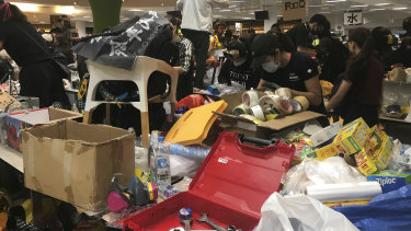 Inside Polytechnic University supplies are piled on tables like a protester supermarket.