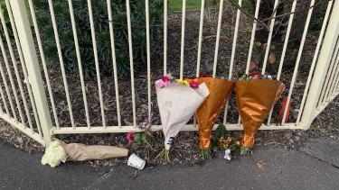 Flowers left outside the flats on Sunday morning.