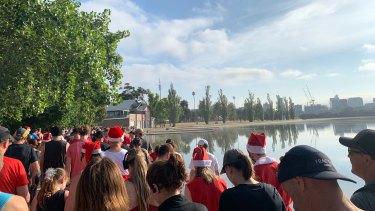 Melburnians enjoy sunny skies at the Albert Park fun run on Christmas Day morning.