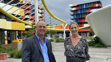 Smith Collective general manager Matt Taplin with marketing manager Alex Slingsby. Seventeen of the 19 former Games village apartment towers are now rented at 80 per cent occupancy.