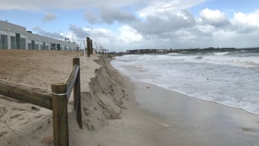 Tuesday's storm, the first big one of 2020, washed away part of the sand at Port Beach in Fremantle.