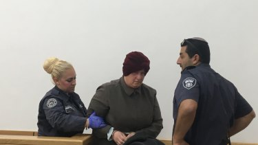 Malka Leifer being led away after she left court early feeling unwell on May 2, 2018.