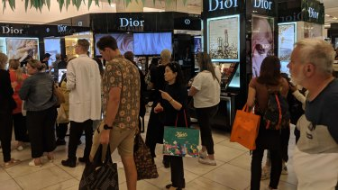 Shoppers queue at Myer's Melbourne CBD store.