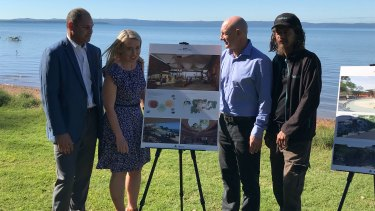 (From left) Cameron Costello, Tourism Minister Kate Jones, Redlands councillor Peter Mitchell and Josh Walker with the plans for QUAMPI.