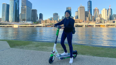 Caroline Goncalves tries out a new Lime scooter in Brisbane.