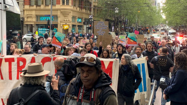 XR activists marched down Collins Street in Friday morning.