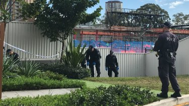 Police on Tuesday morning were combing through the bushes of the building across the road.
