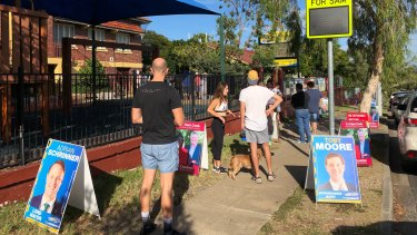 A queue forms at Morningside State School before the voting station is even open.