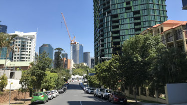 Kangaroo Point is among several suburbs where problems surrounding the installation of expensive firefighting equipment in unit blocks are being felt.
