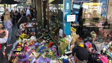 Flowers outside Pellegrini's Espresso Bar on Bourke Street, whose proprietor Sisto Malaspina was killed by Shire Ali.