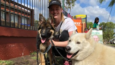Jacqueline, a teacher at Morningside State School, votes with her dogs Honey and Boo.