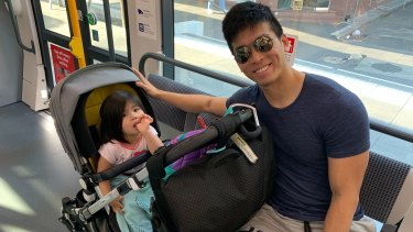 Josh Koh and daughter Arabelle ride the tram from Randwick to the city on Monday morning.