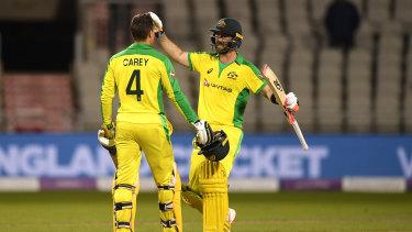Alex Carey and Glenn Maxwell celebrate Carey's maiden ODI ton at Old Trafford.