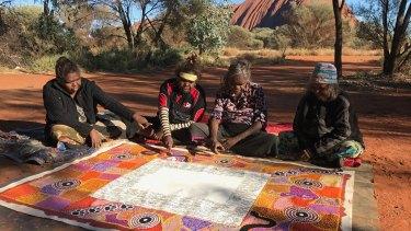 The artists of the Uluru Statement at Uluru in 2017.