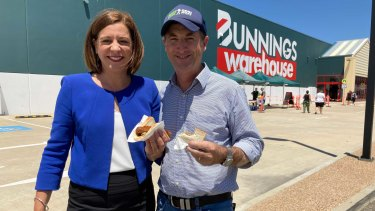 Queensland Opposition Leader Deb Frecklington with husband Jason at the Bunnings Warehouse in Townsville where they sourced their democracy sausages.