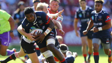 On the charge: The Rebels' Isi Naisarani in action against the Lions.