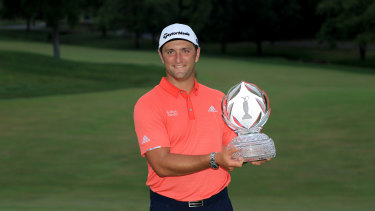 Jon Rahm of Spain celebrates with the trophy after taking out the Memorial Tournament in the US.