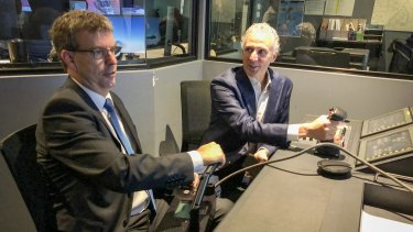 WA Science Minister Dave Kelly and Telstra chief executive Andy Penn at the remote operations centre in Perth.