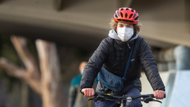 Cyclist Lachlan Goller says he's happy to wear a mask while riding in order to reduce the COVID-19 spread.