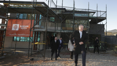 Prime Minister Scott Morrison visits a building site on Thursday. He announced a new scheme aiming to boost construction.
