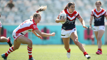 Roosters cross-code star Charlotte Caslick leaves Kezie Apps clutching at air.