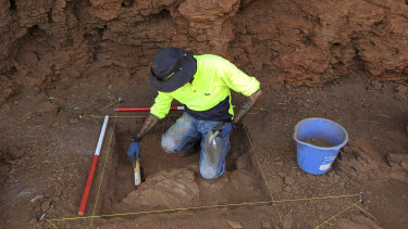 Eastern Guruma traditional owner Kelvin Hughes undertaking excavation within one of the rock shelters.