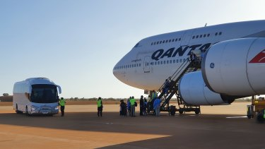 The first Qantas flight from Wuhan arrived at Learmonth RAAF base before evacuees were taken to Christmas Island.