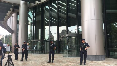 Police officers outside 1 William Street, which was in lockdown ahead of the expected arrival of Extinction Rebellion protesters.