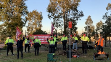 United Workers Union members on strike outside a Woolworths warehouse in Wyong on the Central Coast.