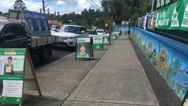 A booth at Paddington isdominated by campaign signs for Greens candidate Donna Burns, who hoped to snatch the ward from LNP incumbent Peter Matic at the Queensland local government election.