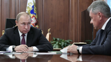 Russian President Vladimir Putin meets Defence Minister Sergei Shoigu on Saturday in the Kremlin in Moscow.