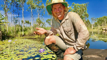 Curtin researcher Adam Cross holding a sample of the rare carnivorous plant in the Kimberley.