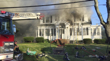 Firefighters battle a house fire in North Andover, Massachusetts.
