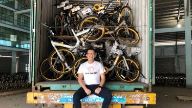 Less Walk founder Mike Than Tun Win with a container of oBikes.
