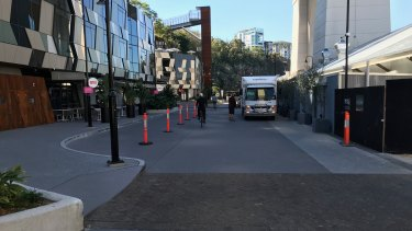 The mixed-use area behind Howard Smith Wharves restaurants where cyclists and pedestrians mix with loading vehicles, private cars and taxis.