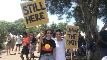 Invasion Day protesters Steffi Davis, 31, and Sophie Curtis, 30,with their signs.