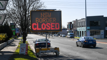 The NSW-Victoria border could be opened over the next month, the NSW Premier has flagged.