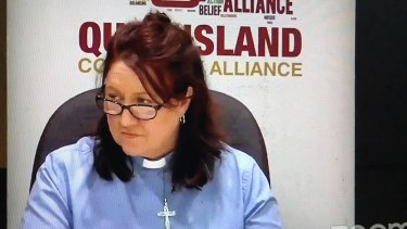 Queensland Community Alliance co-chair Reverend Janet Staines listens during last night's election debate.