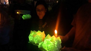 Glowing paper lotus flowers ready to be released in memory of Celeste Manno.