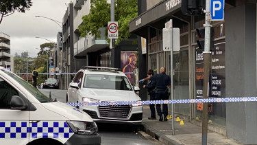 Police analyse a white Audi found near the scene of the shooting early on Saturday.