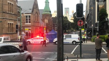 A person has died following a collision with a truck in Surry Hills.